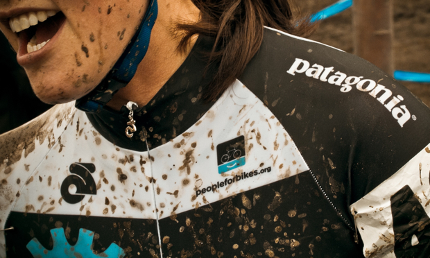 patagonia ad with mud on cyclist