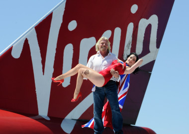 Richard Branson with Dita von Teese at a Virgin media event.