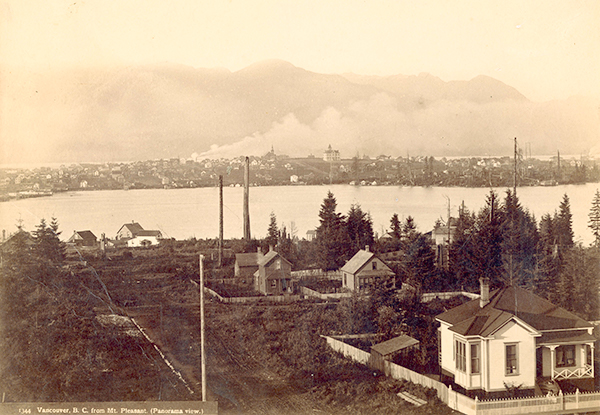 1891; Photograph shows a view of Strathcona and Strathcona School across False Creek from Mount Pleasant.