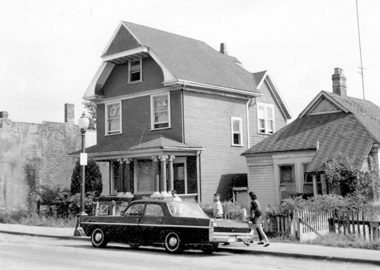 1968 Hogan's Alley, two houses and a dark car