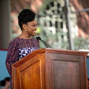 Chimamanda Ngozi Adichie speaking at a podium in May 2018