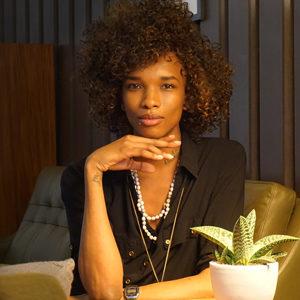 Katlego K Kolanyane-Kesupile seated with her hand under her chin